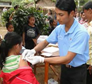 Image of a healthcare provider gives vaccines to children in a village