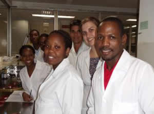 An image of CDC staff and local laboratorian in the lab