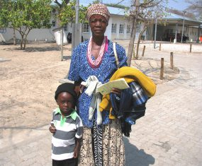 Namibia boy with stripe shirt and mom