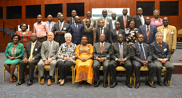 Graduation day (third from left): CDC Country Director Steven Wiersma, Ambassador Deborah Malac, and Uganda's Health Minister Ruth Aceng with FETP fellows and other officials