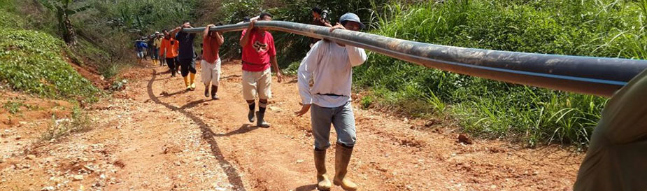 A team of public health officers, public health engineers, and villagers carry pipes to reinstall a water piping system after a massive flood in Kuala Krai District in Kelantan, Malaysia. The flood, which happened on December 24, 2014, destroyed most of the city's water supply system. Clean water was one of main concerns during and after the flood. Submitted by Rosemawati Ariffin – Malaysia.