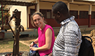 EIS officer Alaine Knipes and DRC FETP graduate Jacques Likofata in Guinea