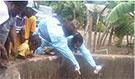 FETP residents taking water sample to test for cholera in Latin America