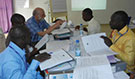 Dr. Eric Brenner CSTE senior epidemiologist consultant detailed to CDC's FETP-STEP training in Cote d'Ivoire, working through disease surveillance exercises with course participants to practice all the components of managing their surveillance data - Yamoussoukro, Cote d'Ivoire January 13, 2015