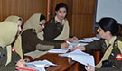 Senior female medical officers in the Pakistan Army doing a class assignment as a group during the diseasesurveillance training workshop in Pakistan, March 2014.