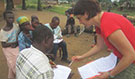 FELTP resident Jacques Likofata and Epidemic Intelligence Officer Dr. Leisha Nolen conducting an interview with a household in the Democratic Republic of Congo during the 2013 human Monkeypox outbreak