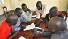 South Sudan FETP residents working on investigation, July 2012