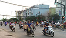 Motorcyclists on a busy street in Ho Chi Minh City.