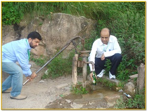 FETP Pakistan graduates Dr. Furgan and Dr. Muhammad Bilal Khan try to collect another water sample from a second source of community drinking water in the Punjab province in Pakistan.