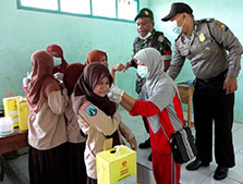 A team from the district health office and police respond to a diphtheria outbreak at a junior high school in Bondowoso District, East Java, Indonesia in June 2011. 37.9% of children at the school were suffering from diphtheria.