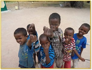 Children in Dadaab Town in North Eastern Kenya show their marked fingers after being vaccinated against polio during the in-process monitoring following the wild type poliovirus outbreak in May 2013.  Nyeri , Kenya,