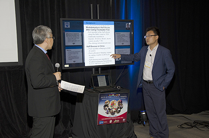 Dr. Qin Wei of China presents his interactive poster presentation.
