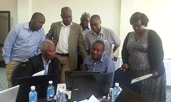 Participants conducting group work during the zoonotic disease prioritization workshop, Kenya, September 2015