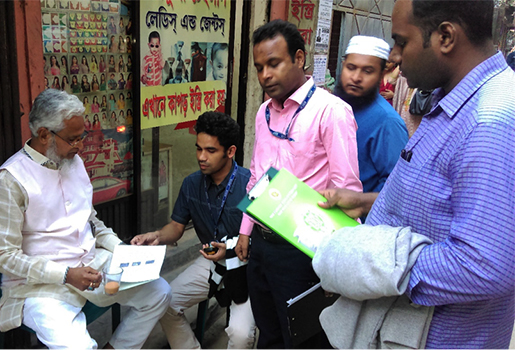 FETP fellows Dr. Omar Qayum (second from left) and Dr. Sirajul Islam (third from left) sharing chikungunya information with a community member in Dhaka, Bangladesh on June 17, 2017.