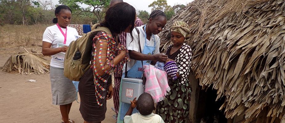 Giving an infant an oral vaccination in Nigeria.