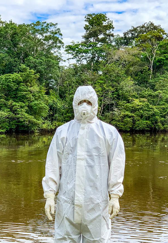 FETP resident wearing personal protective equipment (PPE) while investigating COVID-19 in the Amazonas state of Colombia.