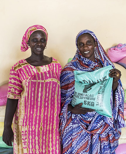 Tabaski Gaye (l) and Arame Gaye are members of the Khar Yalla Gueye, a women's group operating a small-scale grain milling operation in Senegal. Photo: Scott McPherson, RTI International