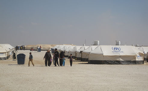 Tents house refugees in Za'atari refugee camp, 2012 (Source: Farah Husain, CDC)