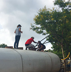 testing free chlorine residual in a water truck that has just been filled (Source: Anu Rajasingham, CDC)