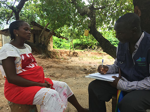 Disease detective Victor Inhane conducts Zika case investigation in a Guinea-Bissau community.