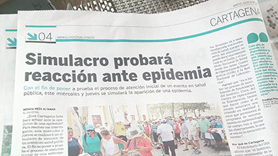 A news headline in Colombia announces the simulation exercise.