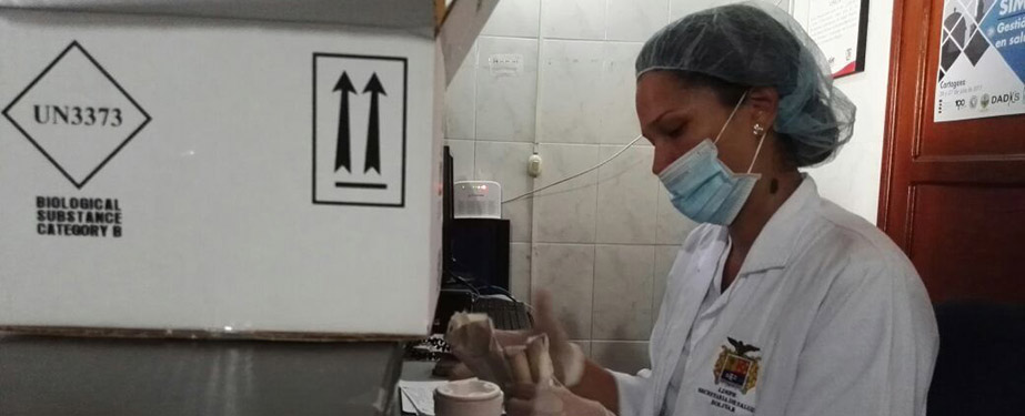 A Colombian lab worker tests samples as the exercise progresses.