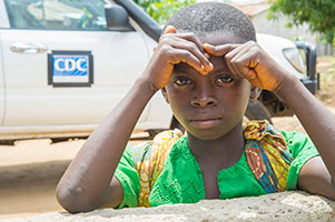 boy in front of CDC surveillance truck during Ebola outbreak