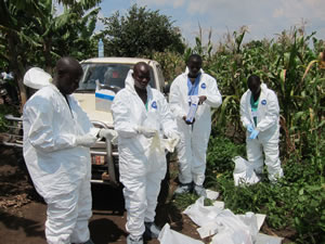 Health workers put on biohazard suits.