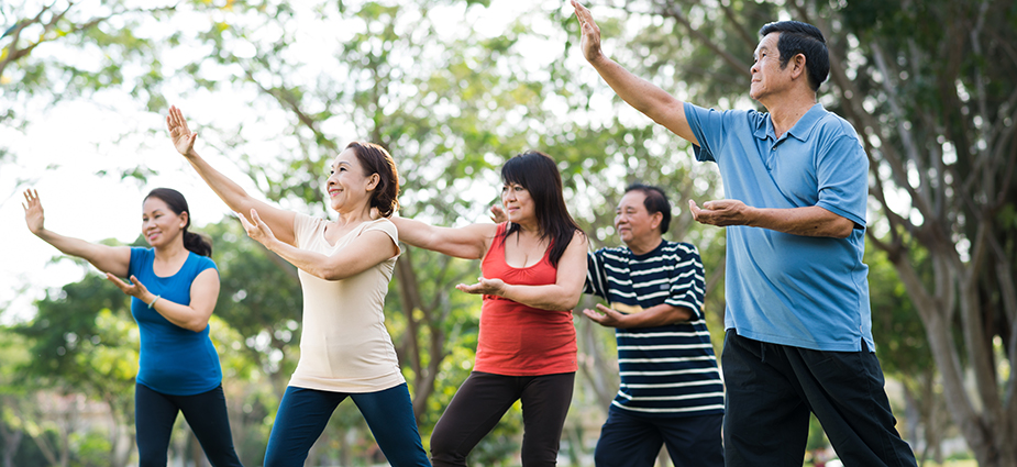 Older Asian adults practice Tai Chi.