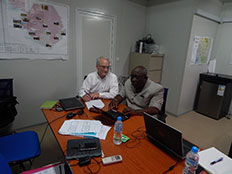 Dennis Jarvis (CDC NPHI Program) receives guidance from the Sierra Leone NPHA development lead, Dr. T.T. Samba.