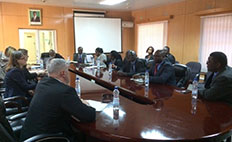 Representatives from CDC, the International Association of National Public Health Institutes, and ZNPHI meet with Zambia's Disaster Management and Mitigation Unit to discuss plans for Zambia's PHEOC.