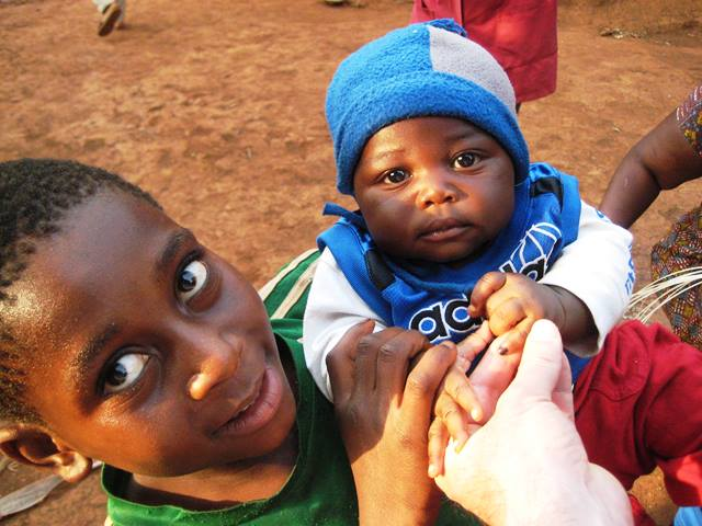 Cameroon: The temporary mark on this baby's finger verifies that he received the polio vaccine.