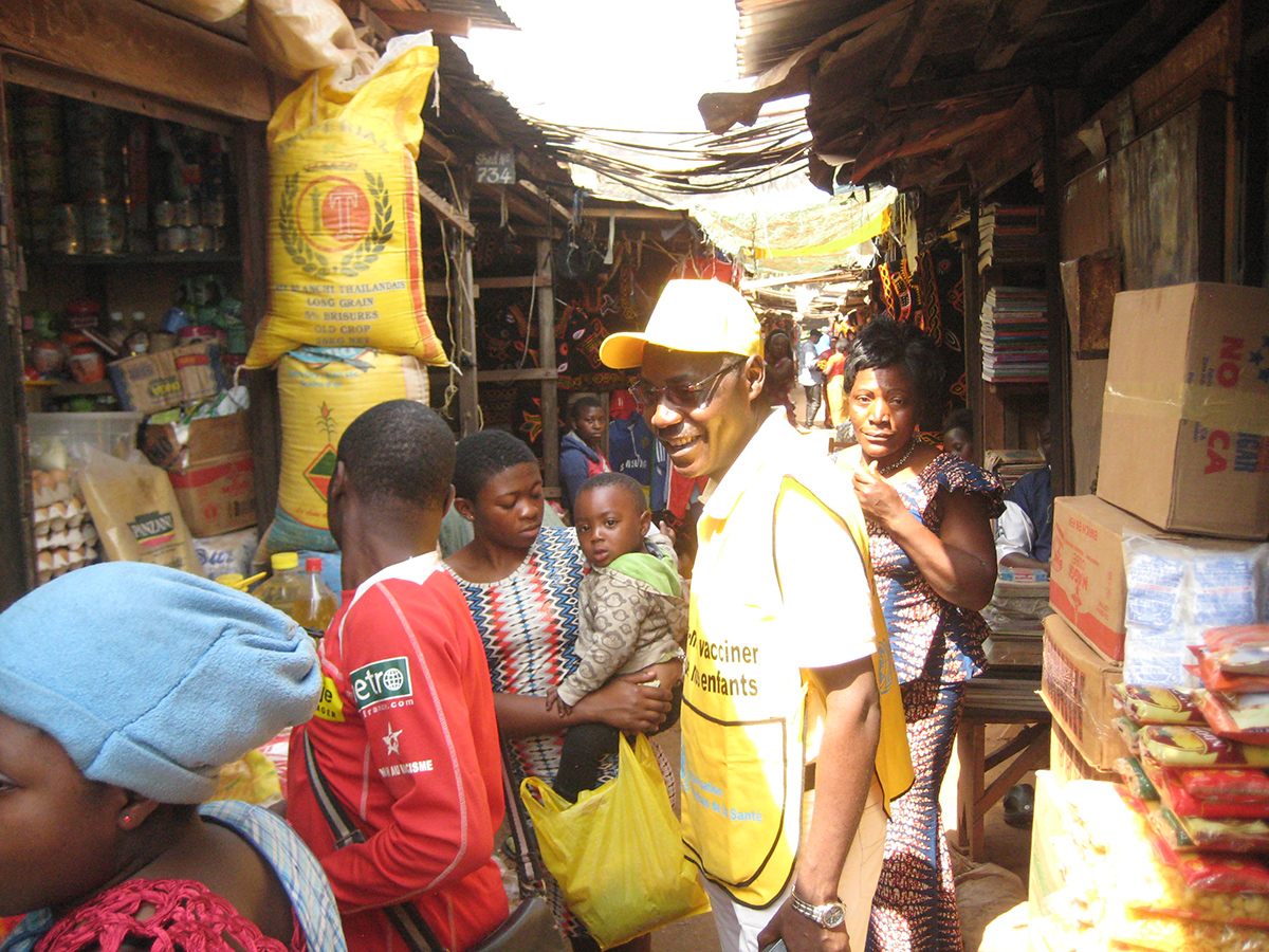 Cameroon: Vaccination teams in a market place promoting the polio campaign
