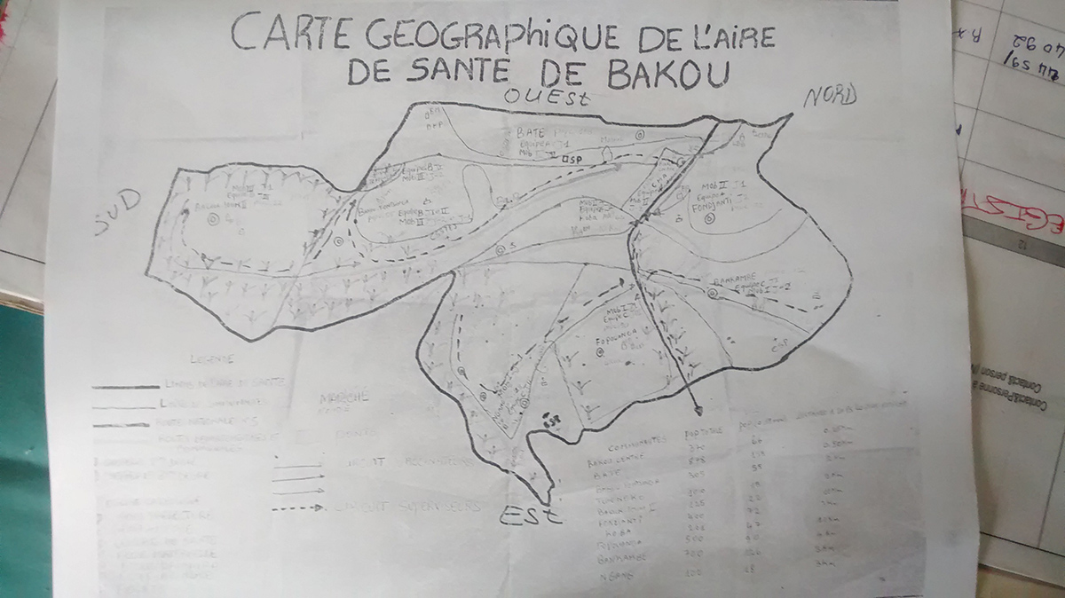 Cameroon: A microplan map of Bakou district in Cameroon. Microplans are used to plan all of the details for immunization campaigns including the locations of villages, schools, health centers, difficult-to-reach areas, target populations, and resources needed. Hand-drawn maps such as the one in this photo are in the process of being replaced with more accurate, digitized microplan maps in Cameroon.