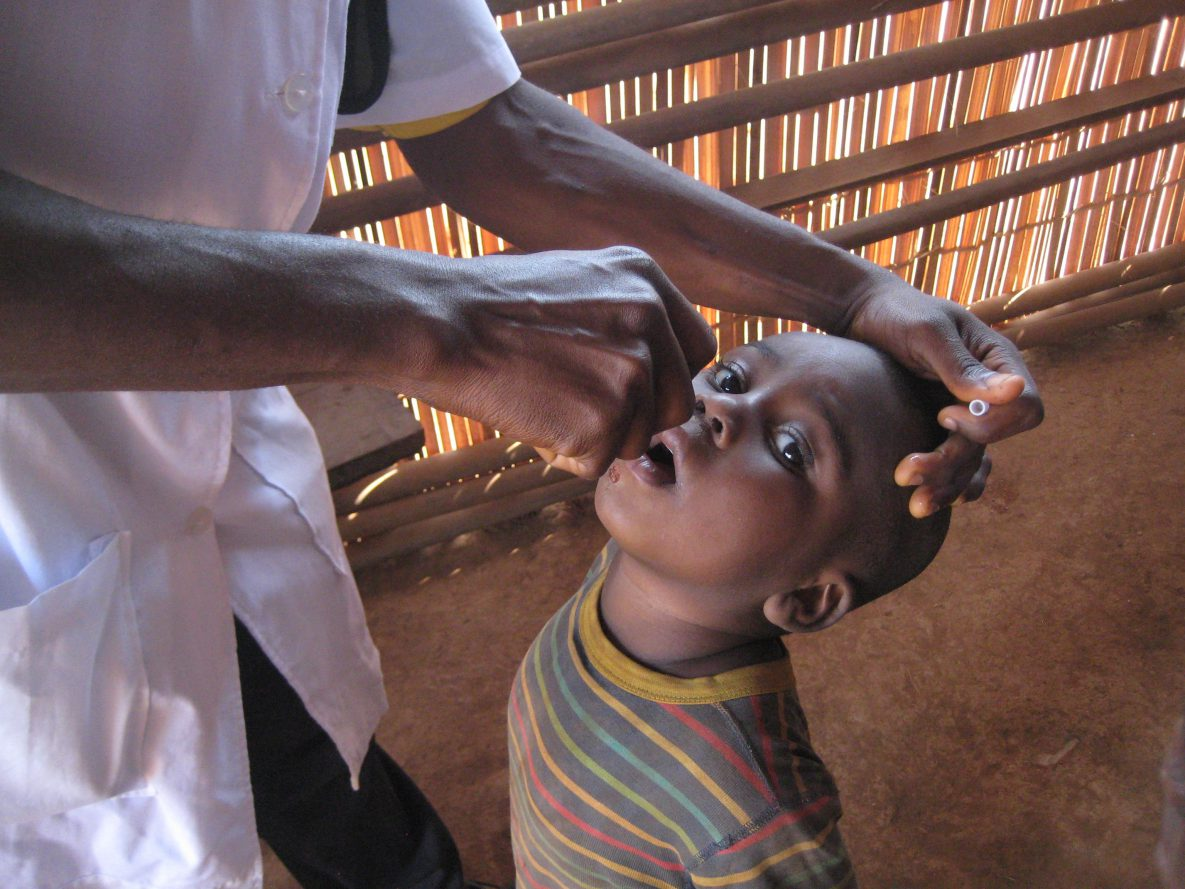 Cameroon: This child looks on as he receives his dose of the oral polio vaccine in the North West region of Cameroon.