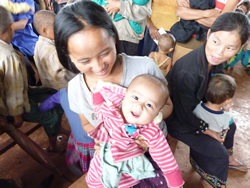 Mother and baby at outreach vaccination activity in northern Laos, courtesy of Karen Hennessey.