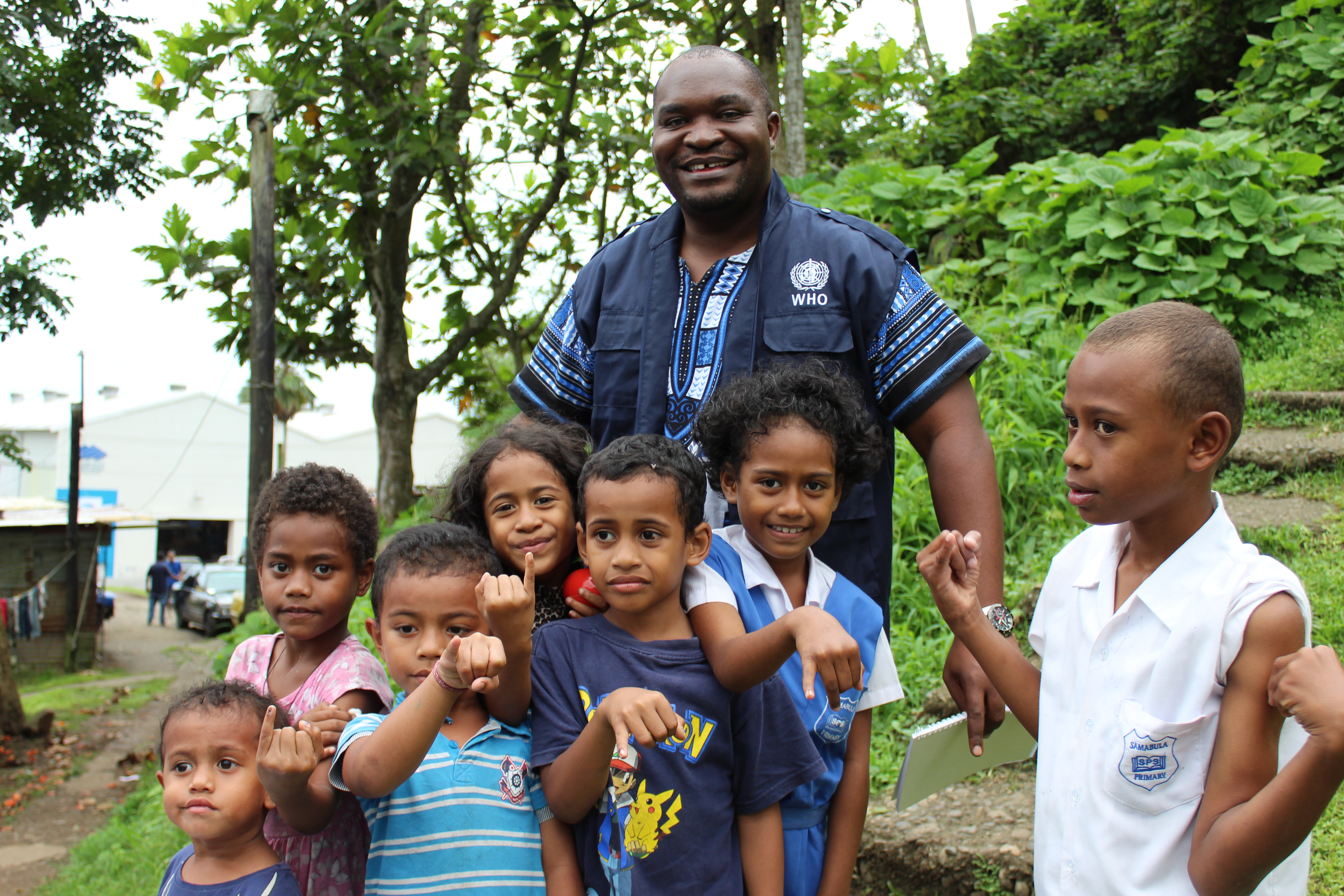 STOP participant in Fiji with children during a vaccination campaign