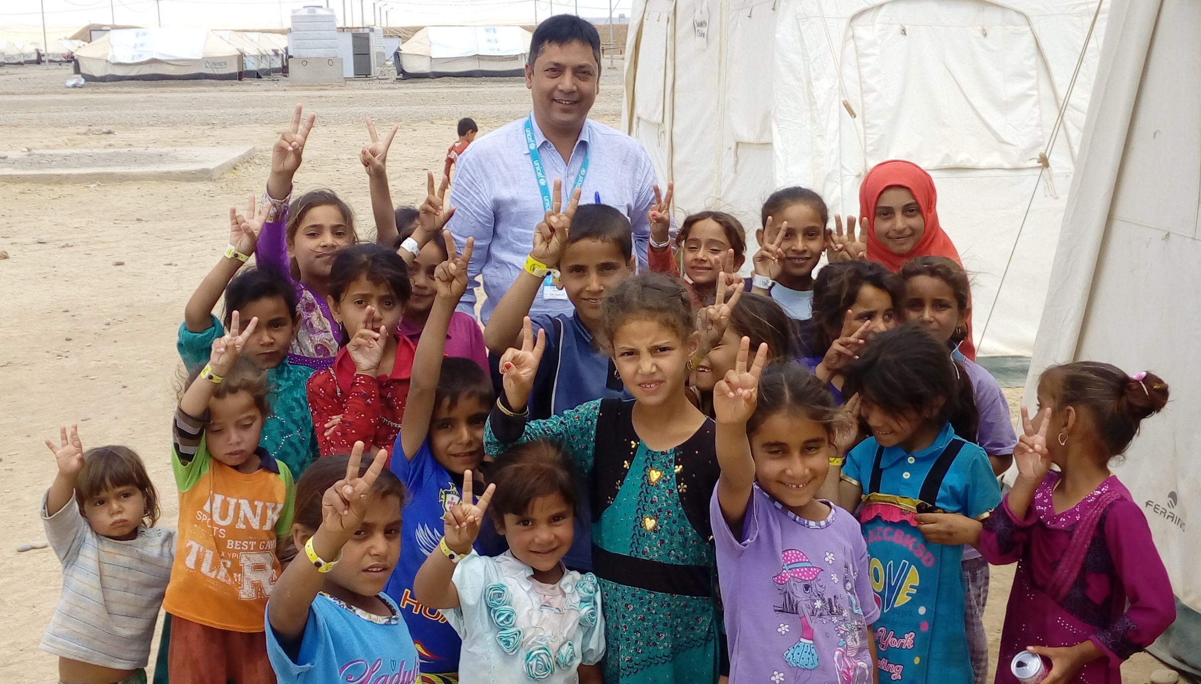 Smiling children and STOP participant in Syria after successful vaccination campaign
