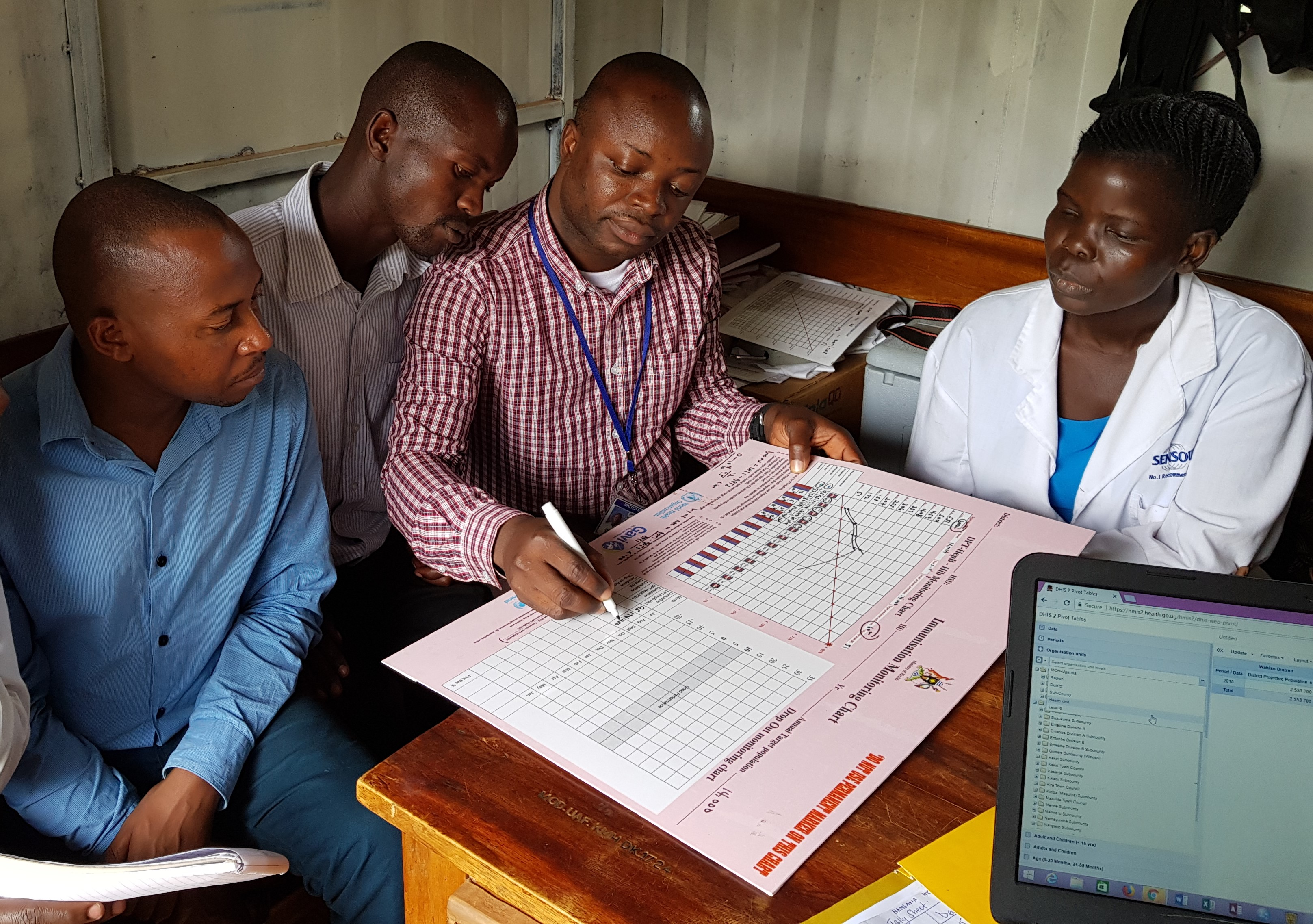 STOP participant training health workers in Uganda on completing vaccine monitoring charts