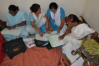 Auxiliary nurse-midwives practice developing annual immunization plan during regular meeting. Photo courtesy of Steve Stewart, CDC.