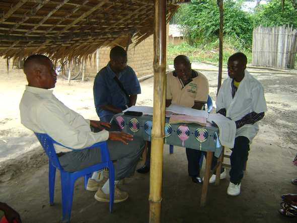 DRC National Expert Group on Immunization Data Quality Members conducting a data quality interview in Kasai Occidental. Photo courtesy of Daline Derival/CDC.