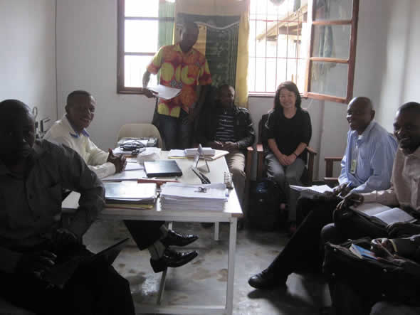 CDC's Chung-won Lee with members of the National Expert Group on Data Quality and health staff in Lukonga, Kasai Occidental during a post-data quality assessment debriefing session. Photo courtesy of Daline Derival/CDC.