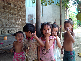 Young children show off their purple pinkies to confirm that they have received the measles-rubella vaccine during the November 2013 campaign. Photo courtesy of Sue Chu/CDC.