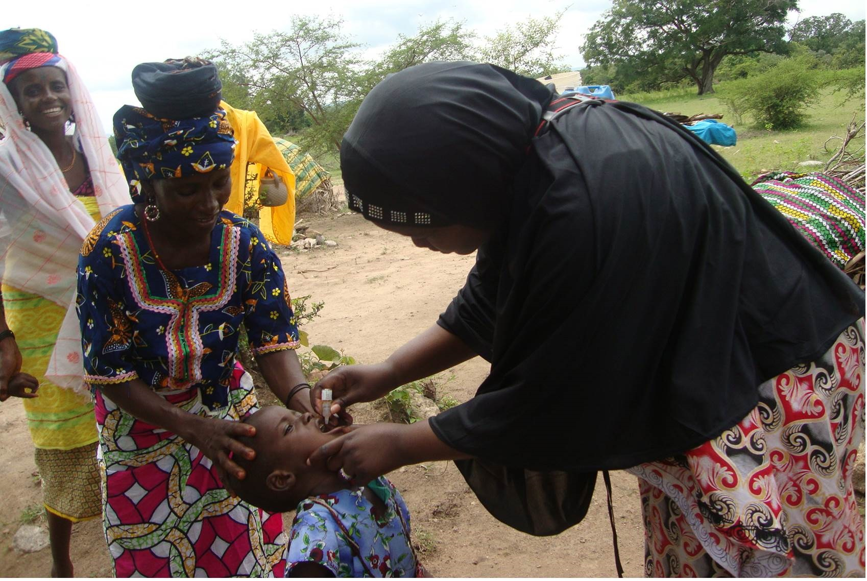 N-STOP officer giving 2 drops of oral polio vaccine to a child in a nomadic settlement in Bauchi State