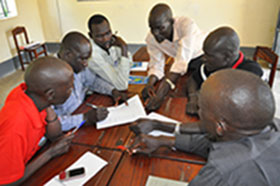 South Sudanese immunization officers working on a case study to apply new knowledge