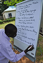 Taking notes at a training workshop in South Sudan, July 2012
