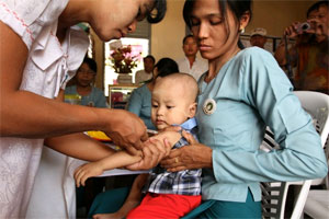 Child receiving measles vaccine.