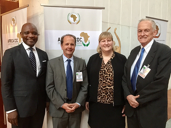 CDC Center for Global Health (CGH) former directors Dr. Tom Kenyon and Dr. Kevin De Cock pose with current CGH Director Dr. Rebecca Martin and Africa CDC Director Dr. John Nkengasong.