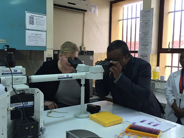 In Kinshasa, Democratic Republic of Congo (DRC), Dr. Rebecca Martin, Director of CDC's Center for Global Health, and Dr. Jean-Jacques Muyembe, Director-General of the DRC National Institute for Biomedical Research (INRB), check out new lab equipment and examine malaria sporozoites under the lens. Mosquitoes carry these parasites, which can cause infections of malaria in humans. So far 5,000 lab techs have been trained in malaria diagnostics and surveillance through a partnership between DRC's Ministry of Health and CDC.
