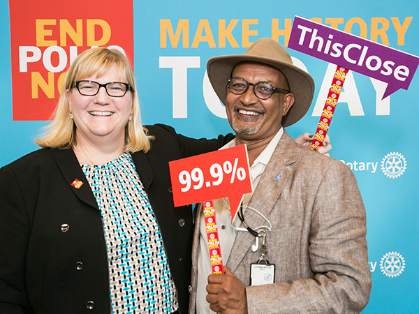 Dr. Rebecca Martin, Director of CDC's Center for Global Health, with Elias Durry, AFRO Team Lead for CDC's Global Immunization Division at the 2016 World Polio Day event in Atlanta. The event, hosted by Rotary International and CDC, raised awareness for the eradication of polio.